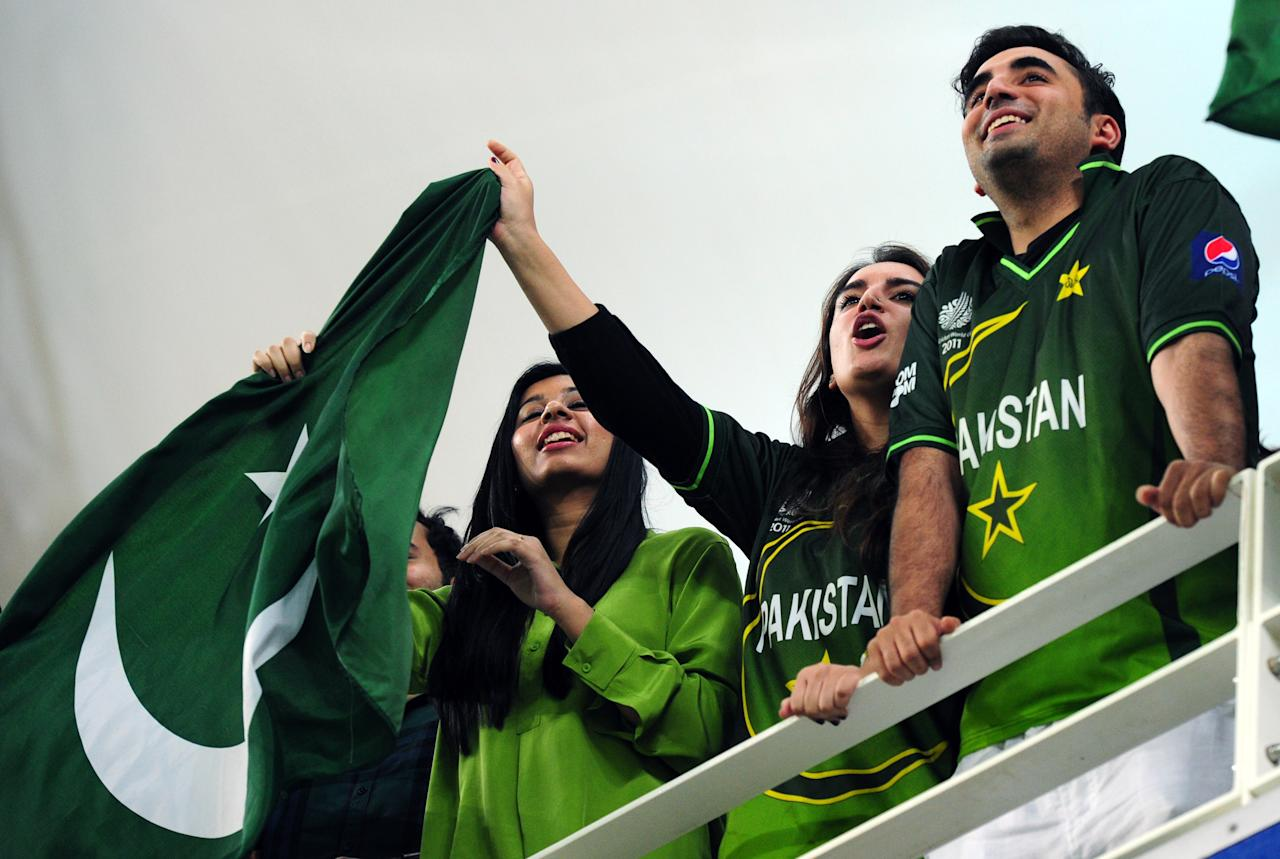 Bilawal Bhutto Zardari (R) and Bakhtawar Bhutto Zardari (2nd R), children of Pakistani President Asif Ali Zardari and late premier Benazir Bhutto, cheer their team on during the First T20 International between Pakistan and South Africa at Dubai stadium on November 13, 2013. Pakistan captain Mohammad Hafeez won the toss and elected to bat in the first Twenty20 international against South Africa in Dubai . AFP PHOTO/ Asif HASSAN        (Photo credit should read ASIF HASSAN/AFP/Getty Images)