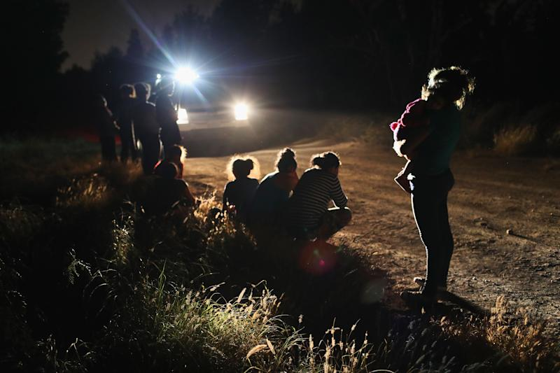 U.S. Border Patrol agents arrive to detain a group of Central American asylum seekers near the U.S.-Mexico border on June 12, 2018, in McAllen, Texas. The group of women and children had rafted across the Rio Grande from Mexico and were detained before being sent to a processing center for possible separation.