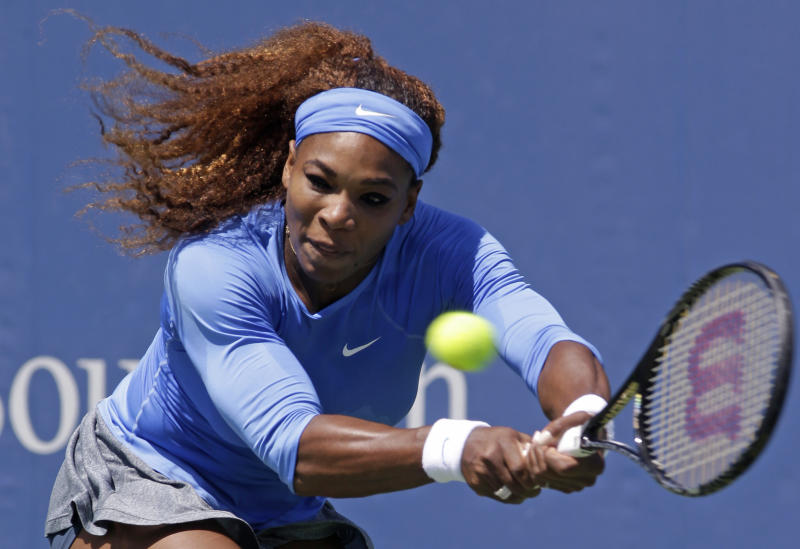 Serena Williams hits a backhand against Eugenie Bouchard, from Canada, during a match at the Western & Southern Open tennis tournament, Wednesday, Aug. 14, 2013, in Mason, Ohio. (AP Photo/Al Behrman)