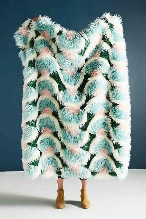 "<a rel=""nofollow"" href=""https://www.anthropologie.com/shop/juniper-faux-fur-throw-blanket?category=new-bedding-bath&color=045"" rel=""nofollow"">SHOP NOW</a>: Juniper Faux Fur Throw Blanket by Anthropologie, $128, anthropologie.com"