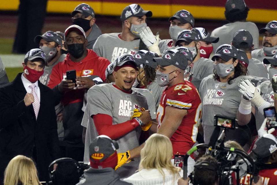 Kansas City Chiefs quarterback Patrick Mahomes celebrates with Kansas City Chiefs tight end Travis Kelce (87) and teammates after the AFC championship game against the Buffalo Bills on Jan. 24, 2021. The Chiefs won 38-24. (AP Photo/Jeff Roberson)