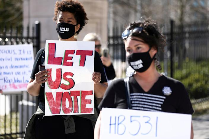 Protesters gather to protest HB 531, which would place tougher restrictions on voting in Georgia, in Atlanta on March 4, 2021. (Dustin Chambers / Reuters file)