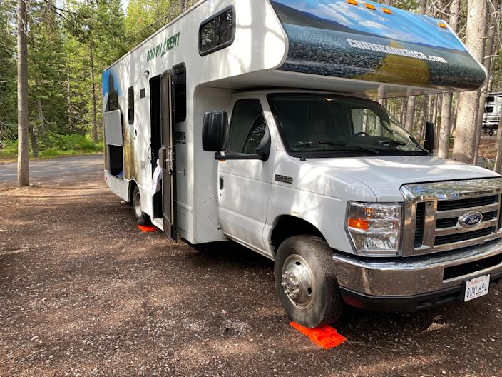The RV is parked on blocks in order to stay level.