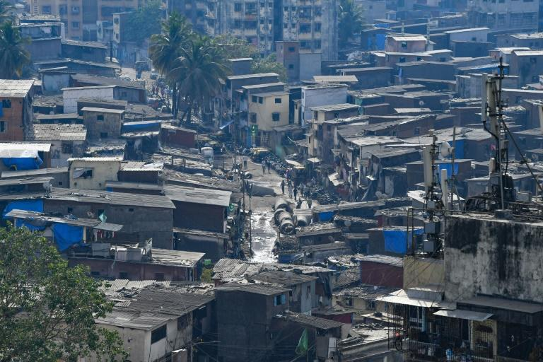 Social distancing is near impossible for the roughly one million people in the Dharavi slum in Mumbai (AFP Photo/INDRANIL MUKHERJEE)