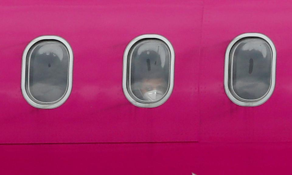 A passenger wearing a protective face mask is seen aboard a Wizz Air Airbus A320. Photo: Andrew Boyers/Reuters