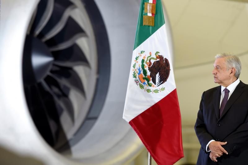 Mexican President Andres Manuel Lopez Obrador attends a press conference, with the presidential plane in the background, at the presidential hangar of the Benito Juarez International Airport in Mexico City, on July 27, 2020. (Photo by ALFREDO ESTRELLA / AFP) (Photo by ALFREDO ESTRELLA/AFP via Getty Images)
