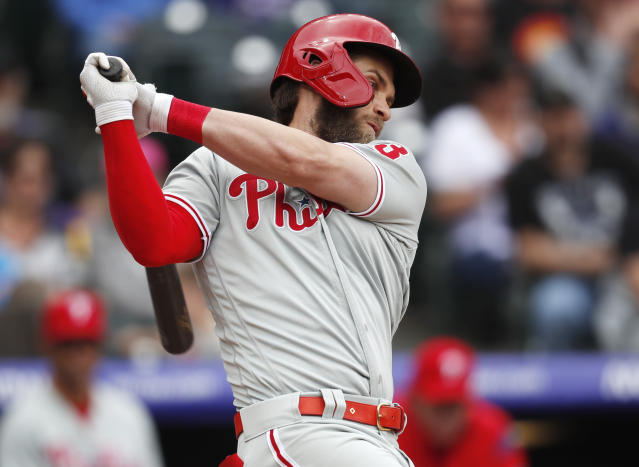 Philadelphia Phillies' Bryce Harper strikes out against Colorado Rockies starting pitcher Jon Gray in the fourth inning of a baseball game Sunday, April 21, 2019, in Denver. (AP Photo/David Zalubowski)