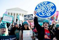 Abortions rights activists protest outside the US Supreme Court (AFP/SAUL LOEB)