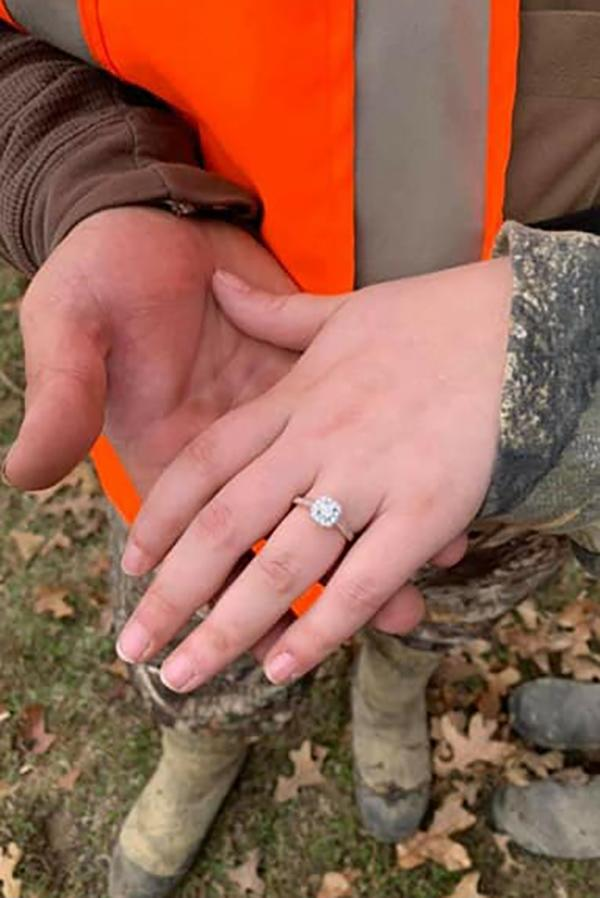 Man holds fiancee's hand after proposing