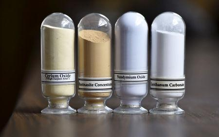 FILE PHOTO: Samples of rare earth minerals from left, Cerium oxide, Bastnasite, Neodymium oxide and Lanthanum carbonate are on display during a tour of Molycorp's Mountain Pass Rare Earth facility in Mountain Pass, California June 29, 2015. REUTERS/David Becker/File Photo