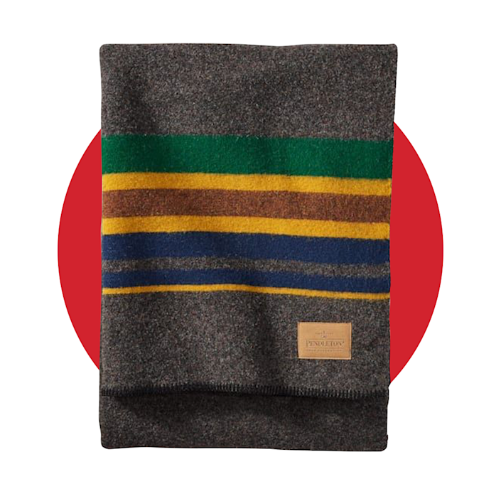 """<p>pendleton-usa.com</p><p><strong>$169.00</strong></p><p><a href=""""https://www.pendleton-usa.com/product/yakima-camp-blanket/70302.html"""" rel=""""nofollow noopener"""" target=""""_blank"""" data-ylk=""""slk:BUY IT HERE"""" class=""""link rapid-noclick-resp"""">BUY IT HERE</a></p><p>Ah, there's nothing like gathering 'round a cozy fire with an even cozier blanket. Pendleton's classic Camping Blanket (now in a new colorway for the season) is made from soft and durable wool, making it a staple for any outdoor trip.</p>"""