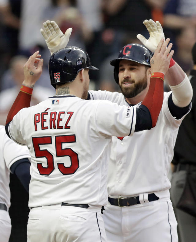 Cleveland Indians' Jason Kipnis, right, is congratulated by Roberto Perez after Kipnis hit a three-run home run off Baltimore Orioles starting pitcher Gabriel Ynoa in the fourth inning of a baseball game, Thursday, May 16, 2019, in Cleveland. Perez and Jordan Luplow scored on the play. (AP Photo/Tony Dejak)