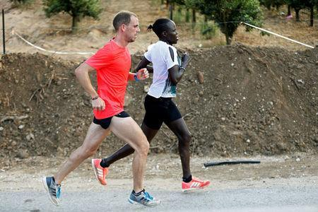 Lonah Chemtai, a Kenyan-born runner who will represent Israel in the women's marathon at the 2016 Rio Olympics, trains with her husband and coach, Israeli Dan Salpeter, near their house in Moshav Yanuv, central Israel July 14, 2016. REUTERS/Baz Ratner