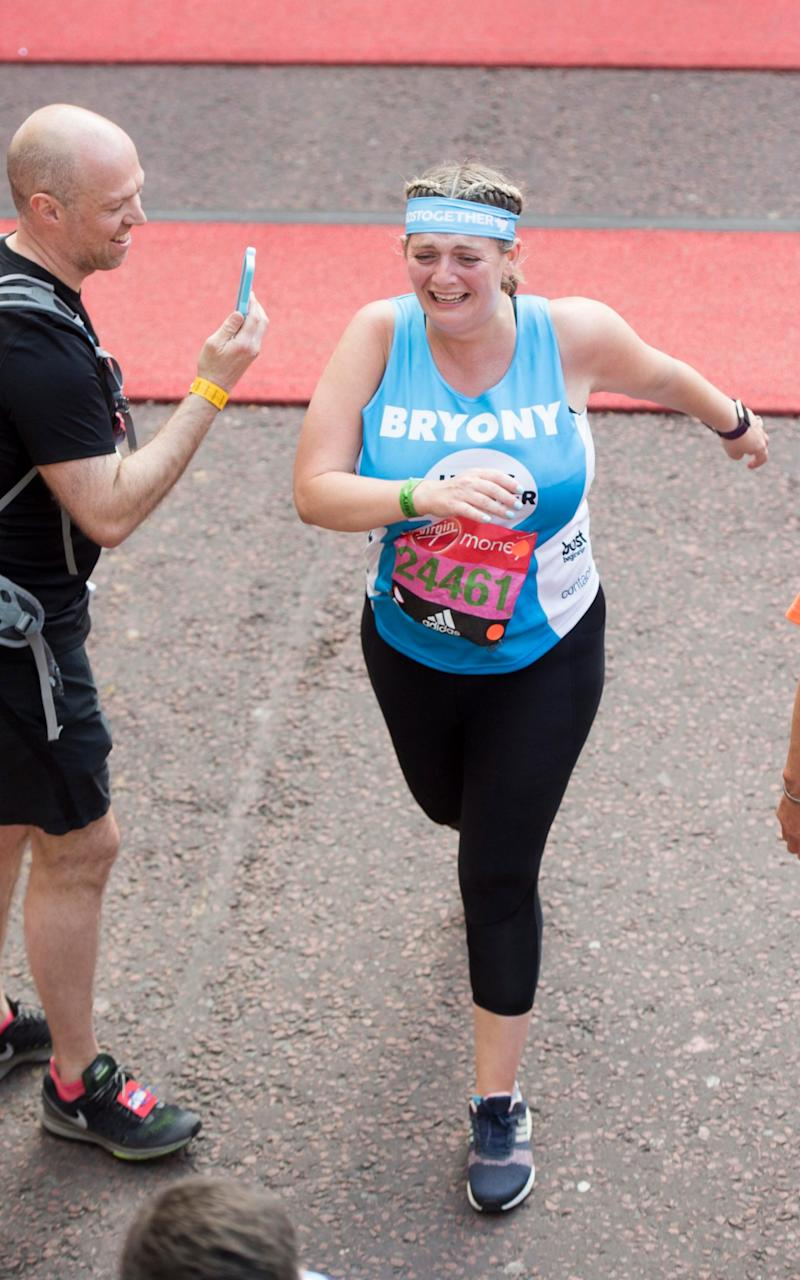 Bryony Gordon crosses the finish line - Credit: Paul Grover