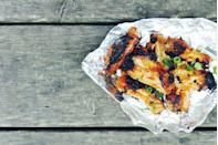 """<p>Nothing sizzles like spicy wings under the night sky.</p><p>Get the recipe from <a href=""""https://www.delish.com/cooking/recipe-ideas/recipes/a43212/foil-pack-sriracha-honey-wings/"""" rel=""""nofollow noopener"""" target=""""_blank"""" data-ylk=""""slk:Delish"""" class=""""link rapid-noclick-resp"""">Delish</a>.</p>"""