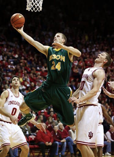 North Dakota State's Taylor Braun (24) shoots against Indiana's Cody Zeller (40) during the first half of an NCAA college basketball game, Monday, Nov. 12, 2012, in Bloomington, Ind. (AP Photo/Darron Cummings)