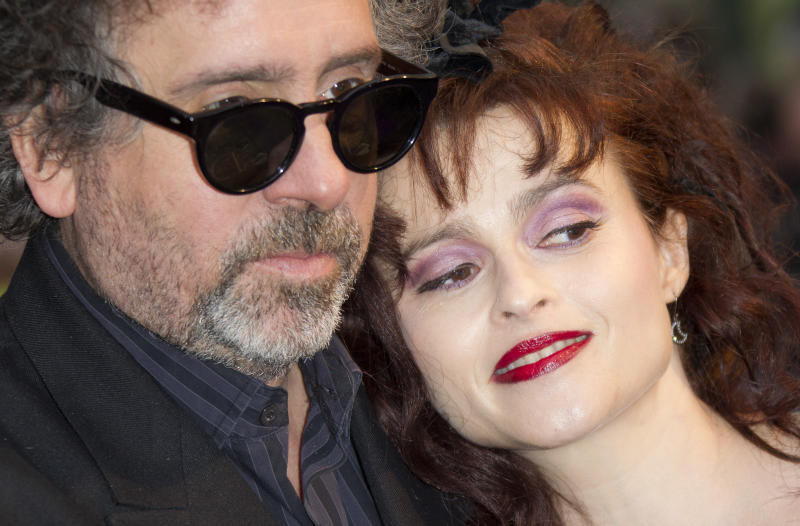 Director Tim Burton and wife Helena Bonham Carter arrive for the UK Premiere of 'Dark Shadows', at a central London cinema, Wednesday, May 9, 2012. (AP Photo/Joel Ryan)