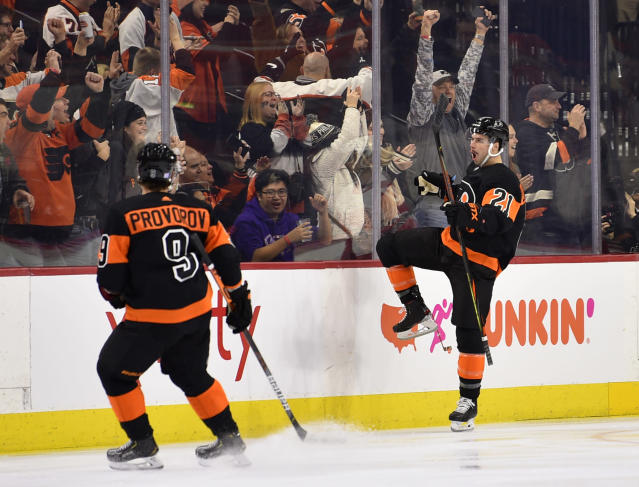 Philadelphia Flyers' Scott Laughton, right, celebrates after scoring a goal during the first period of an NHL hockey game against the Detroit Red Wings, Friday, Nov. 29, 2019, in Philadelphia. (AP Photo/Derik Hamilton)