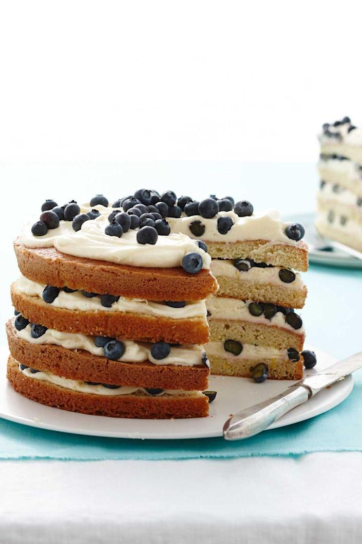 """<p>This layered number, which overflows with vanilla icing and fresh blueberries, will be the highlight of your mom's day. </p><p><a href=""""https://www.womansday.com/food-recipes/food-drinks/recipes/a13417/lemon-blueberry-layer-cake-recipe-wdy0414/"""" rel=""""nofollow noopener"""" target=""""_blank"""" data-ylk=""""slk:Get the Lemon Blueberry Layer Cake recipe."""" class=""""link rapid-noclick-resp""""><strong><em>Get the Lemon Blueberry Layer Cake recipe. </em></strong></a><br></p>"""