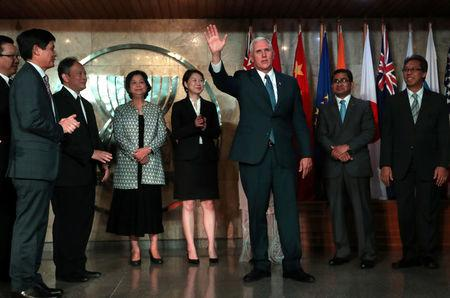 U.S. Vice President Mike Pence waves as he is accompanied by permanent members of the ASEAN at the Association of Southeast Asian Nations (ASEAN) Secretariat in Jakarta, Indonesia April 20, 2017. REUTERS/Mast Irham/Pool