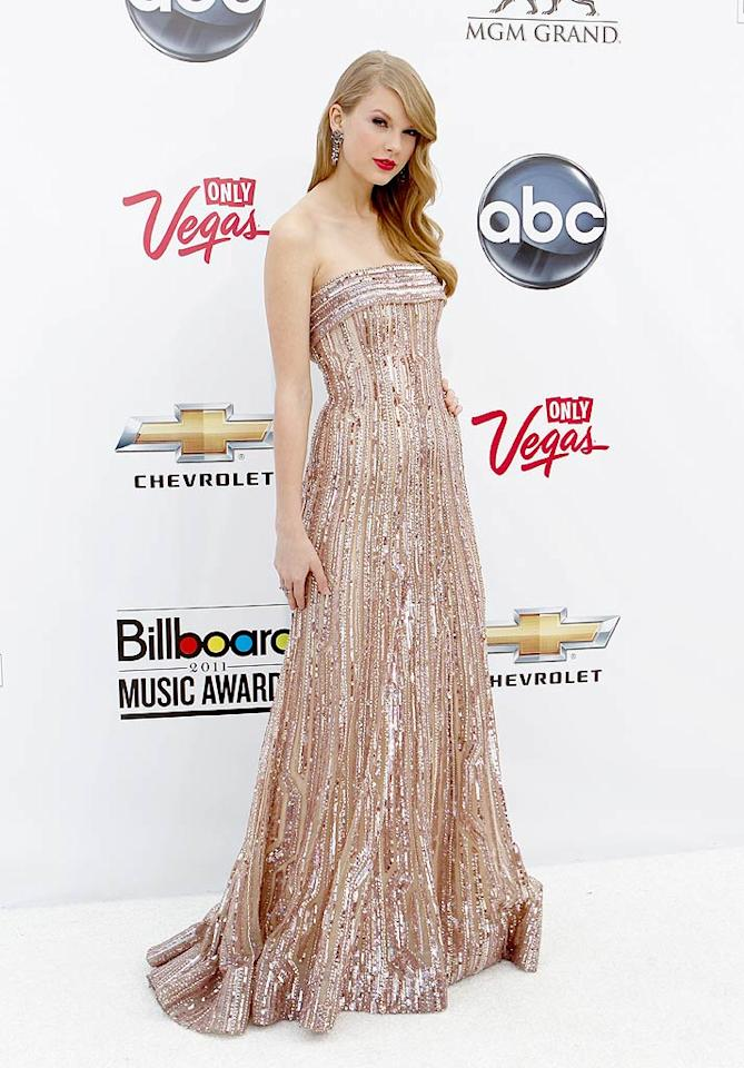 """Country cutie Taylor Swift looked exceptionally glamorous in a bedazzled Elie Saab gown, statement earrings, and wavy tresses. Isaac Brekken/<a href=""""http://www.gettyimages.com/"""" target=""""new"""">GettyImages.com</a> - May 22, 2011"""