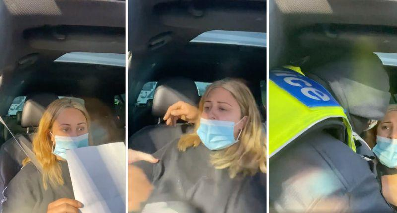 A Victoria Police officer removes Natalie Bonnett from her car.