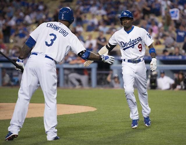 Los Angeles Dodgers' Dee Gordon, right, celebrates with Carl Crawford after hitting a home run during the first inning of a baseball game against the Detroit Tigers in Los Angeles, Tuesday, April 8, 2014. (AP Photo/Kelvin Kuo)