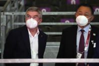 International Olympic Committee's President Thomas Bach, left, visits wheelchair fencing at the Tokyo 2020 Paralympic Games, Wednesday, Aug. 25, 2021, in Chiba, Japan. (AP Photo/Kiichiro Sato)