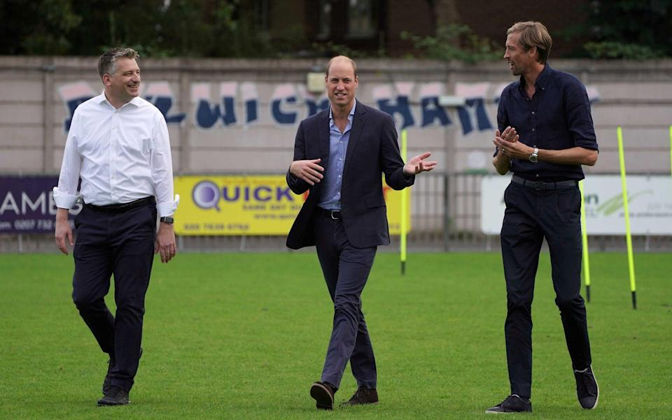 Ben Clasper, the chairman of Dulwich Hamlet Football Club, with Prince William and Peter Crouch - Kirsty O'Connor/REUTERS