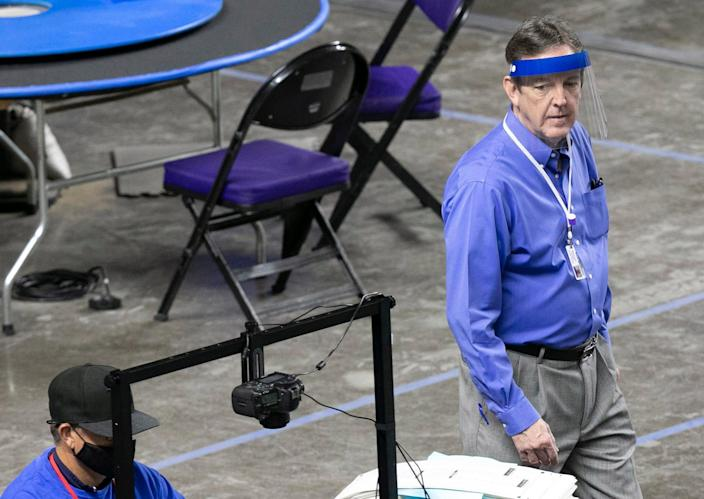 Former Secretary of State Ken Bennett, serving as the  Arizona Senate's liaison, looks on as Maricopa County ballots from the 2020 general election are examined and recounted by contractors hired by the Arizona Senate in an audit at the Veterans Memorial Coliseum in Phoenix on May 11, 2021.
