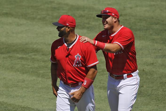 Angels' Albert Pujols and Mike Trout joke around prior to an intrasquad game.