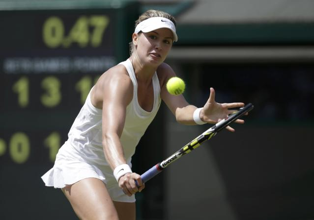 Eugenie Bouchard of Canada hits a return during her women's singles quarter-final tennis match against Angelique Kerber of Germany at the Wimbledon Tennis Championships, in London July 2, 2014. REUTERS/Max Rossi (BRITAIN - Tags: SPORT TENNIS)