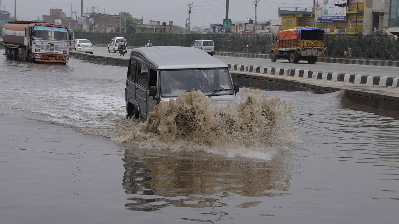 GURGAON, INDIA - JUNE 17: Rain water logging at expressway service lane near Hero Honda Chowk on June 17, 2013 in Gurgaon, India. The city received 60 mm of rainfall.(Photo by Parveen Kumar/Hindustan Times via Getty Images)