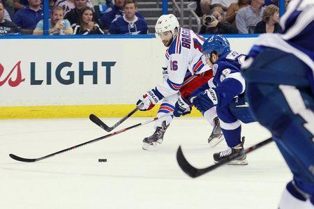 New York Rangers center Derick Brassard (16) battles for the puck with Tampa Bay Lightning defenseman Nikita Nesterov (89) during the third period of game three of the Eastern Conference Final of the 2015 Stanley Cup Playoffs at Amalie Arena. Mandatory Credit: Kim Klement-USA TODAY Sports