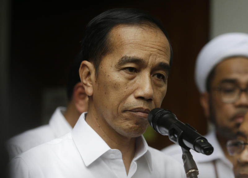 Indonesian President Joko Widodo speaks to journalists after visiting Coordinating Minister for Politics, Law and Security Wiranto who was wounded in a knife attack, at a hospital in Jakarta, Indonesia, Thursday, Oct. 10, 2019. A knife-wielding man, who may have been radicalized by the Islamic State group's extremist ideology, wounded the top security minister, a local police chief and another person in a western province on Thursday, police said. (AP Photo/Achmad Ibrahim)