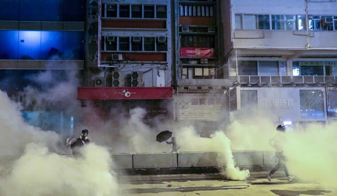 Tear gas is fired by police during clashes with anti-government protesters in Mong Kok on Christmas Day. Photo: May Tse
