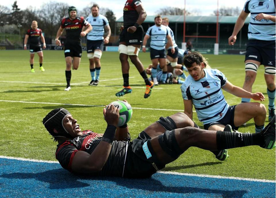 Maro Itoje of Saracens charges down a kick from scrumhalf Connor Tupai and dives on the loose ball to score their third try during the Greene King IPA Championship match between Saracens and Bedford Blues at the StoneX Stadium on April 11 2021 in Barnet, England.
