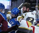 Vegas Golden Knights defenseman Alex Pietrangelo (7) fights with Colorado Avalanche center Tyson Jost (17) in the third period of Game 1 of an NHL hockey Stanley Cup second-round playoff series Sunday, May 30, 2021, in Denver. (AP Photo/Jack Dempsey)