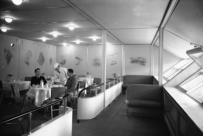 <p>Passengers dine comfortably in the luxurious dining area of the Hindenburg dirigible during the 1930s. (Corbis via Getty Images) </p>