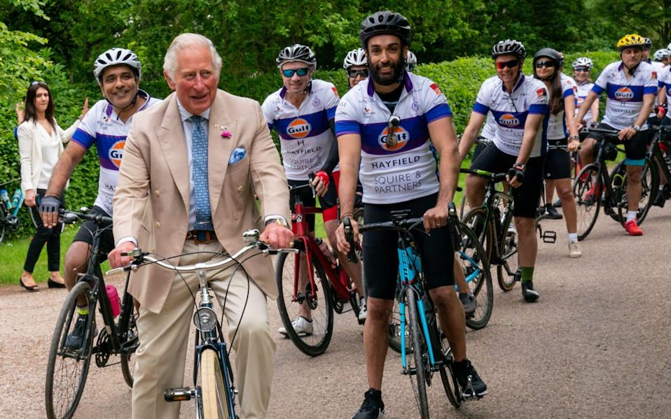 Prince Charles joins members of the British Asian Trust for a short ride - ARTHUR EDWARDS/POOL/AFP via Getty Images