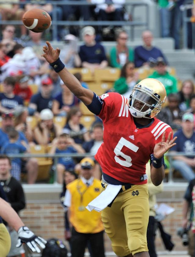 Notre Dame quarterback Everett Golson throws a pass during the second half of Notre Dame's spring NCAA college football game Saturday April 12, 2014 in South Bend, Ind. The Blue Gold game marks the end of spring football practice. (AP Photo/Joe Raymond)