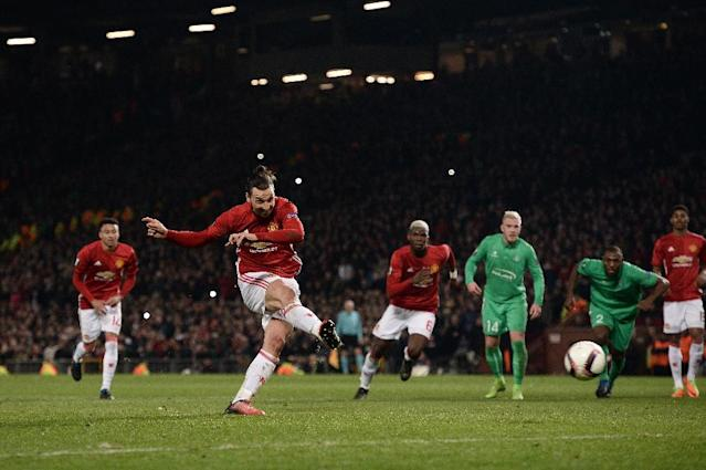 Manchester United's striker Zlatan Ibrahimovic shoots from the penalty spot to score his team's third goal during the UEFA Europa League Round of 32 first-leg football match between Manchester United and Saint-Etienne on February 16, 2017 (AFP Photo/Oli SCARFF )