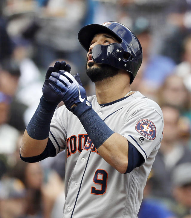 Houston Astros' Marwin Gonzalez looks skyward as he crosses home plate after hitting a home run against the Seattle Mariners in the second inning of a baseball game Wednesday, Aug. 1, 2018, in Seattle. (AP Photo/Elaine Thompson)