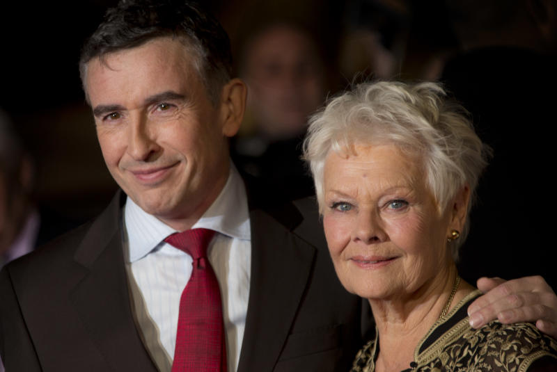 British actors Steve Coogan and Dame Judi Dench pose together during the red carpet arrivals for the screening of Philomena, as part of the 57th BFI London Film Festival, at a central London cinema, Wednesday, Oct. 16, 2013. (Photo by Joel Ryan/Invision/AP)