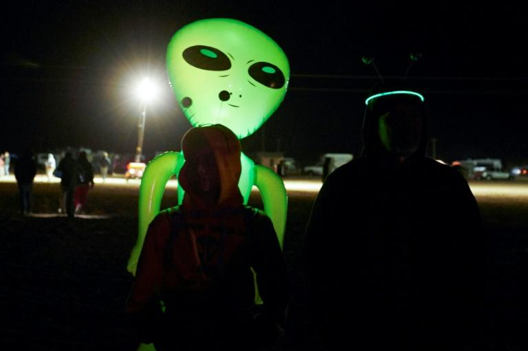 """Alien-hunters gather to """"storm"""" Area 51 at an entrance to the military facility near Rachel, Nevada on September 19, 2019"""
