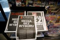 The first pages of Poland's main private newspapers have black front pages with the slogan 'Media without choice' written on them in protest against a proposed media advertising tax