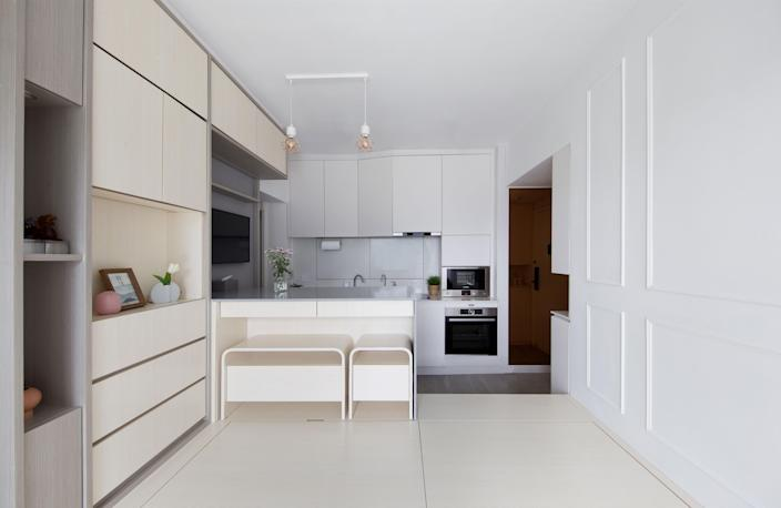 Patrick moved the kitchen into the living room for an open floor plan that feels more spacious.
