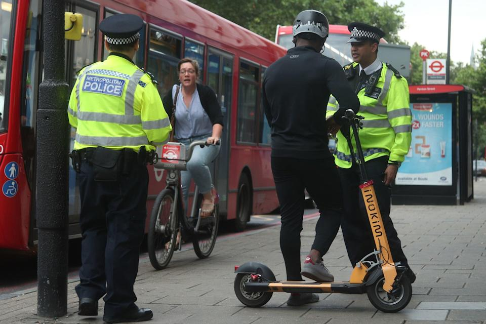 <p>Metropolitan Police officers in Islington talk to people riding e-scooters to educate them on the risks associated with the use of e-scooters</p> (PA)