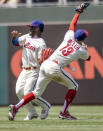 Philadelphia Phillies second baseman Brad Miller, right, and center fielder Odubel Herrera, left, miss a ball hit by Washington Nationals' Victor Robles during the fifth inning of a baseball game, Wednesday, June 23, 2021, in Philadelphia. (AP Photo/Laurence Kesterson)