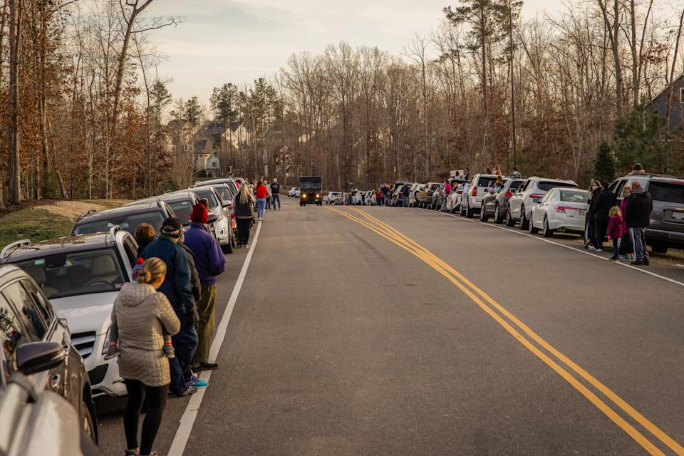 Neighbors lined the streets to greet Gaskin with cheers. (Photo: Lexi Hanrahan Photography)